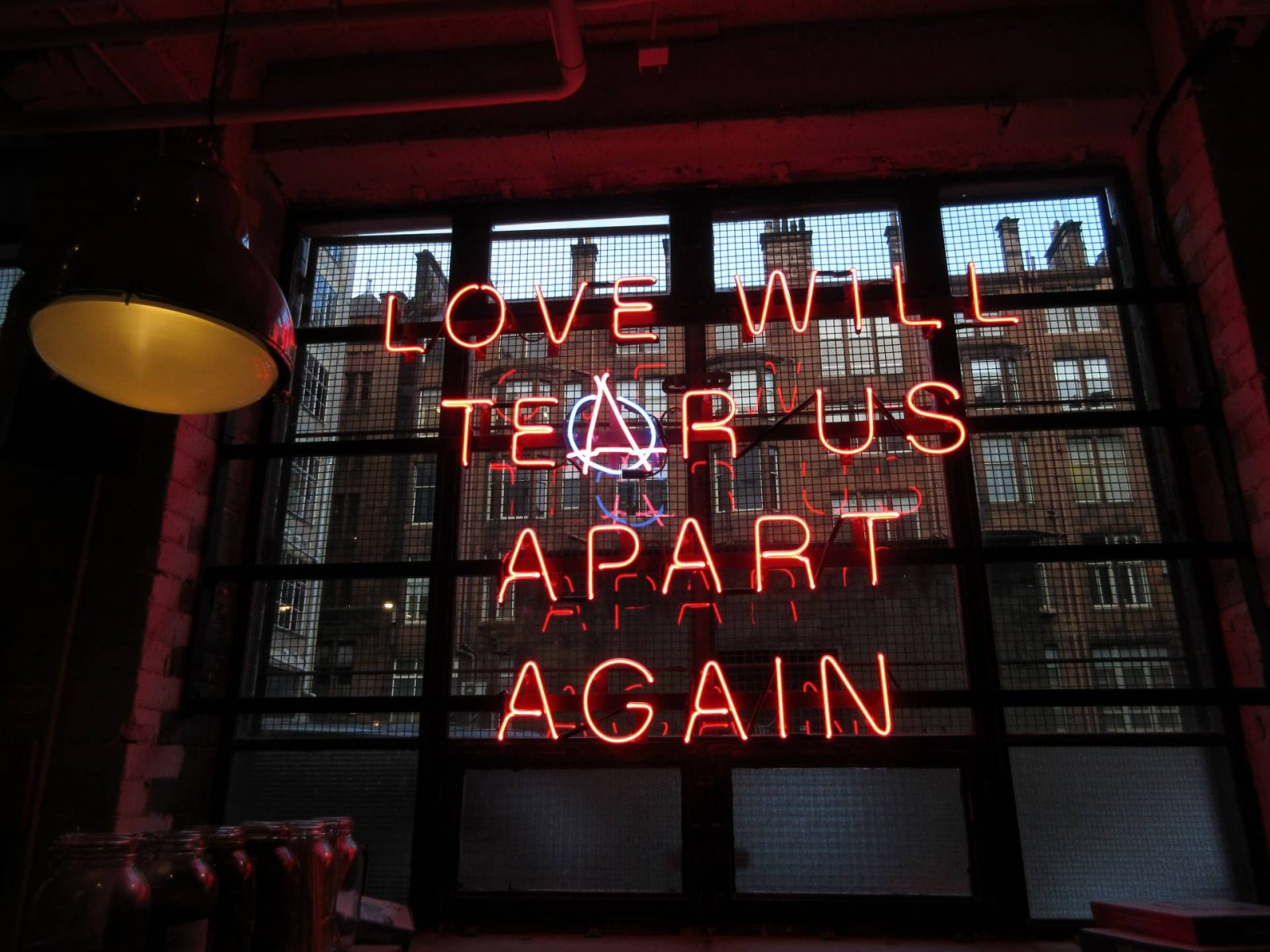 Pizza Punks Glasgow restaurant review - neon Love Will Tear Us Apart sign