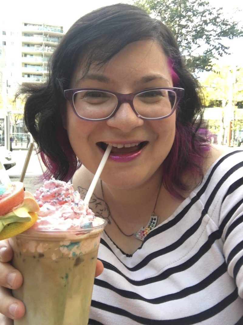 Things to do in Toronto - Lis drinking a unicorn latte from CutiePie Cupcakes & Co