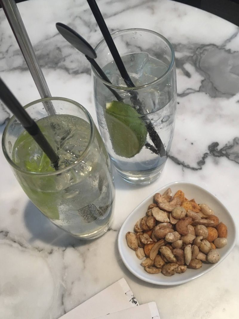 No1 Lounges Gatwick Airport South Terminal review - gin and tonic and bar snacks