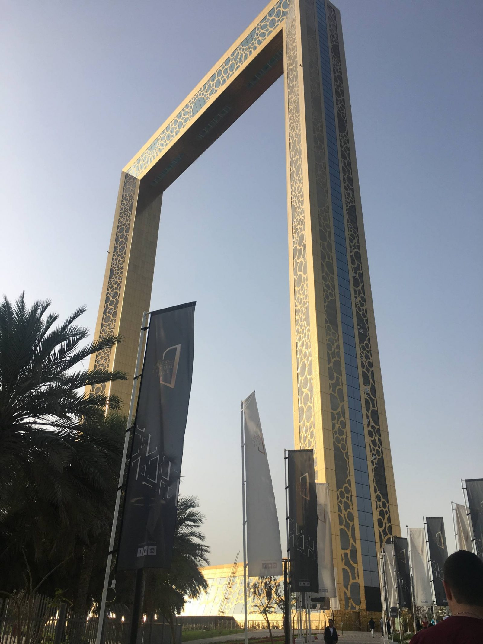 The Dubai Frame, a 150 metre tall golden photo frame in Zabeel Park, Dubai, seen by day