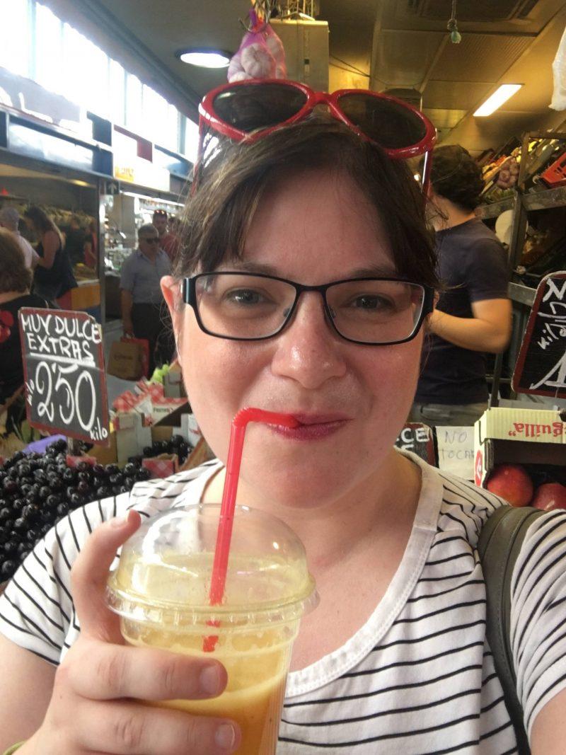 Drinking fresh juice at Atarazanas Market, Malaga