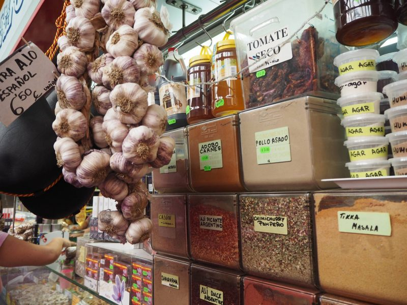 Day trip to Malaga, Spain: Ataranzas Market with whole garlic and spices