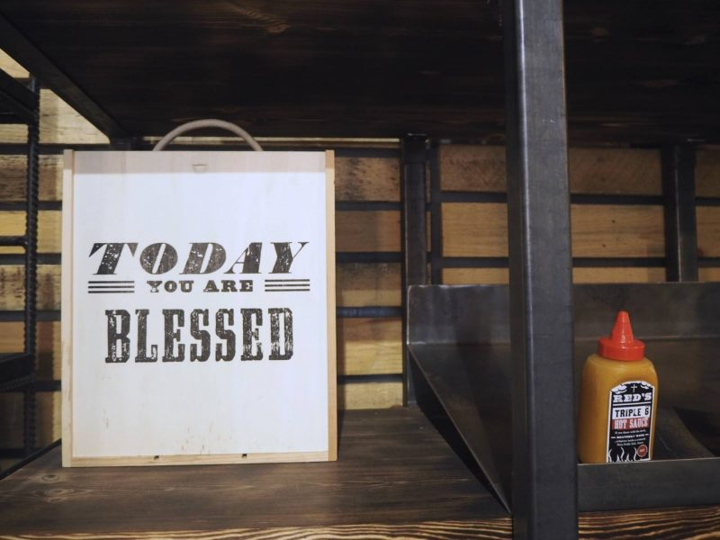 Red's True Barbecue Newcastle review: Today You Are Blessed sign