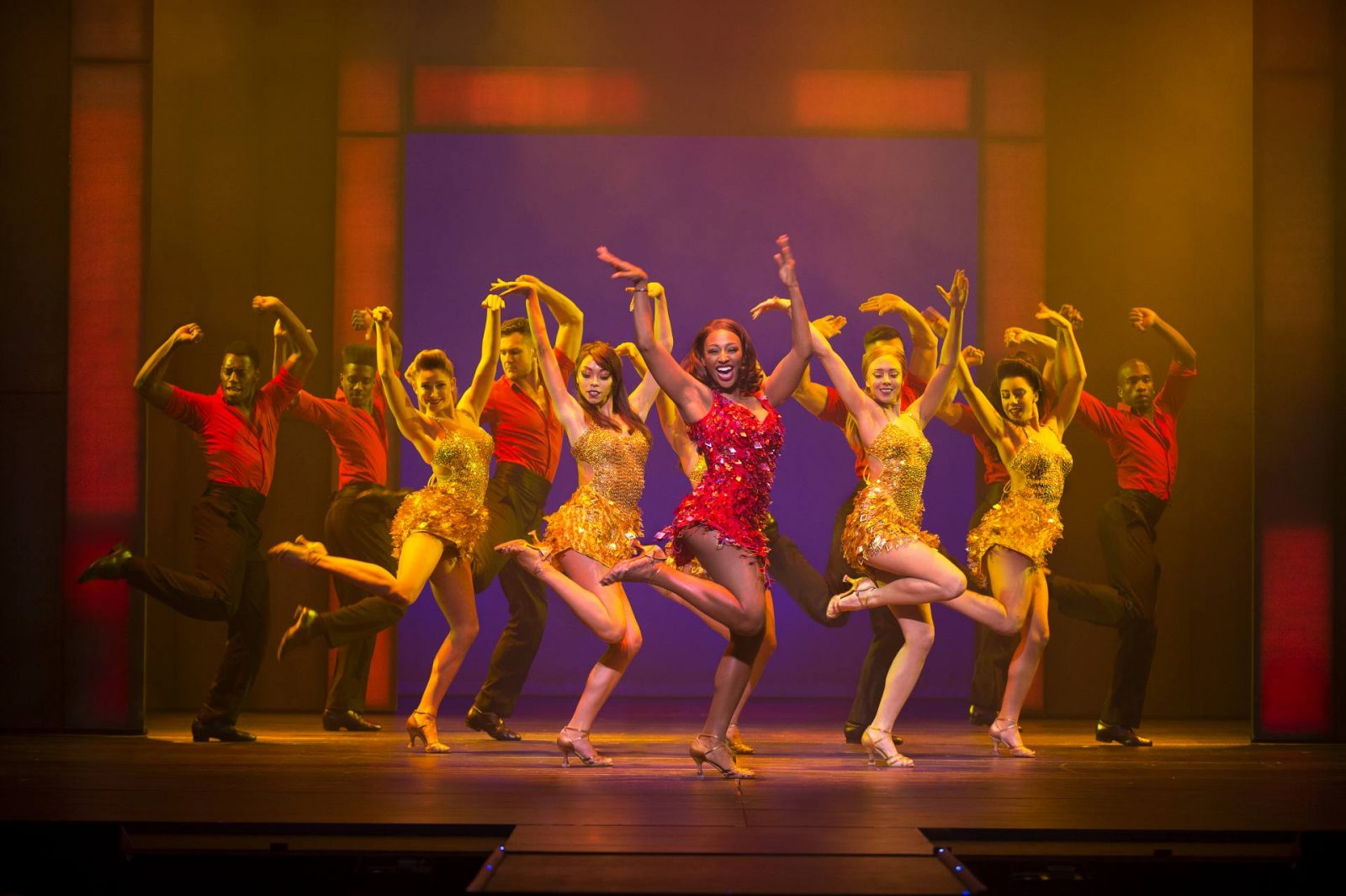 """Alexandra Burke and The Bodyguard ensemble perform """"I'm Every Woman""""; production shot by Paul Coltas, used with permission"""